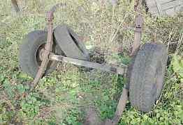 Ось на колёсах с рессорами