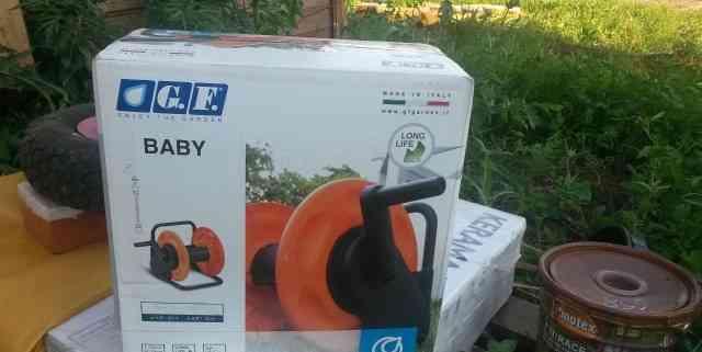 Новая катушка на колесах для садового шланга