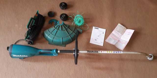 Продам электротриммер для травы Makita UM3830
